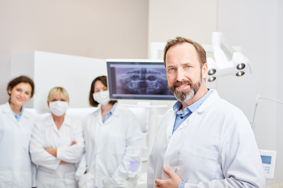 A great dentist in front of team